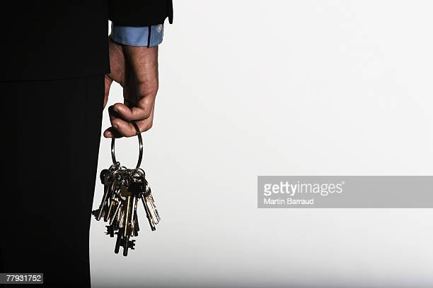 hand holding large ring of keys - key ring stock photos and pictures