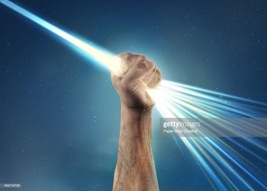 hand holding light laser beam that bursts out : Stock Photo