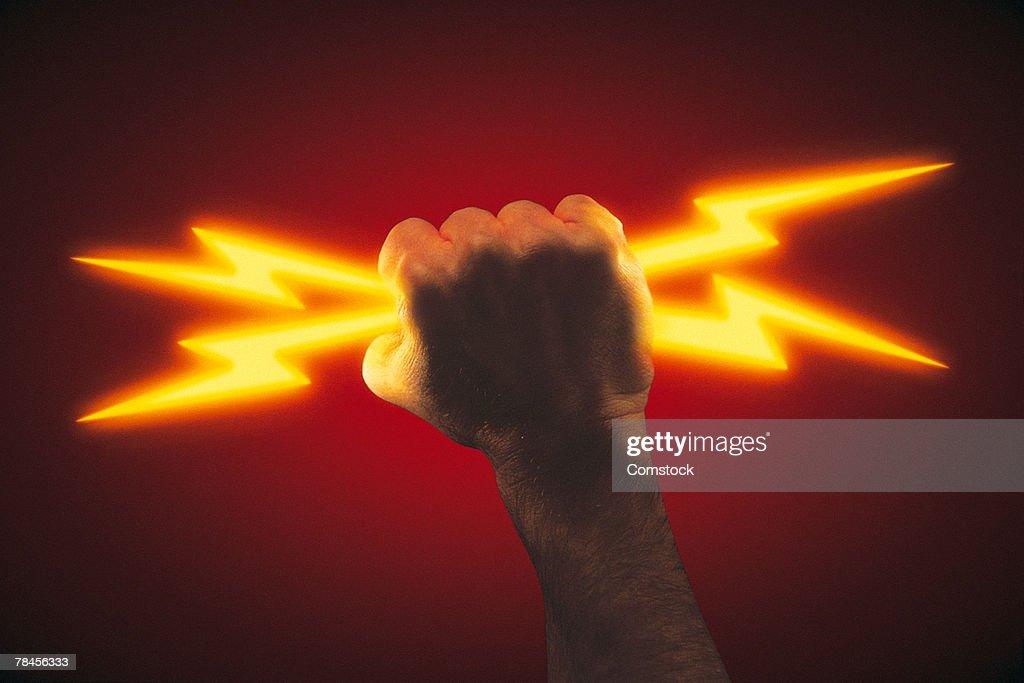 Hand holding lightning bolts : Stock Photo