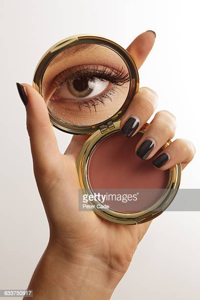 hand holding make up mirror with reflection of eye - powder compact stock pictures, royalty-free photos & images
