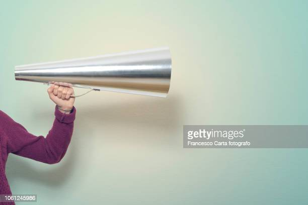 hand holding megaphone - propaganda stock pictures, royalty-free photos & images