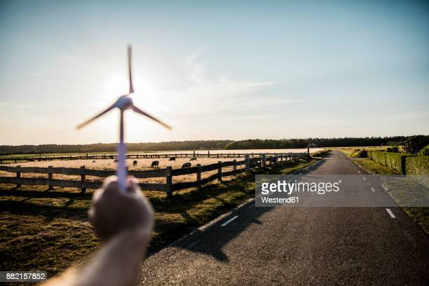 Hand holding miniature wind turbine