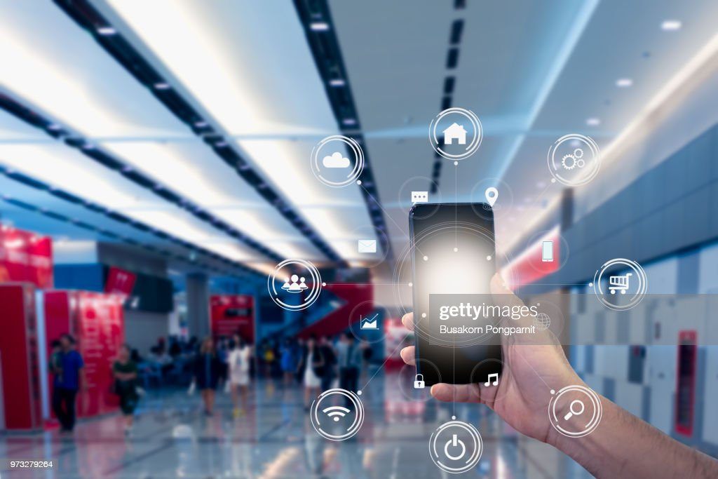 hand holding mobile phone with icons. concept of business and technology communication in the network. : Stock Photo
