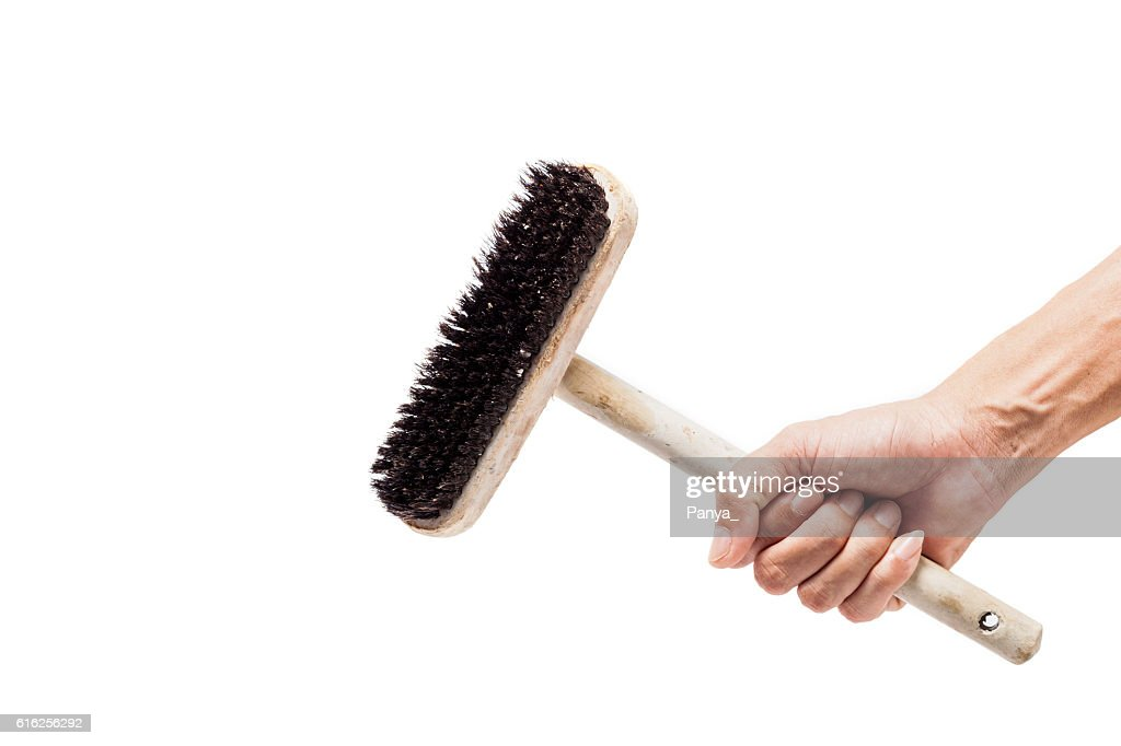 hand holding old wooden clean brush. : Foto de stock