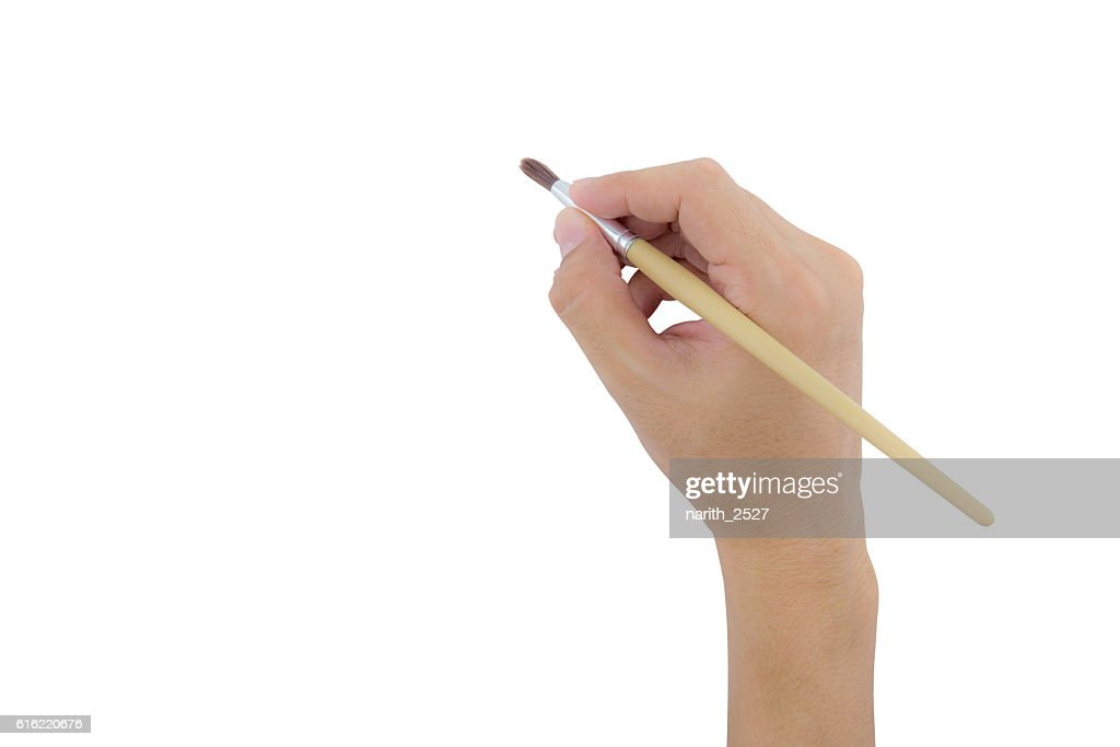 hand holding paint brush isolated over white background : Stock-Foto