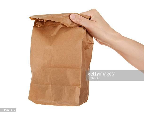 Hand Holding Paper Lunch Bag