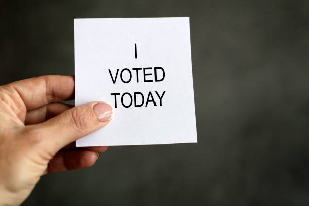 """Hand holding paper with """"I voted today"""" message"""