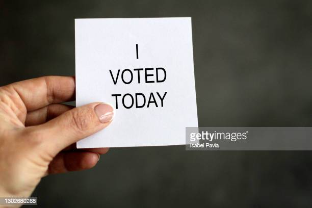 """hand holding paper with """"i voted today"""" message - member of congress stock pictures, royalty-free photos & images"""