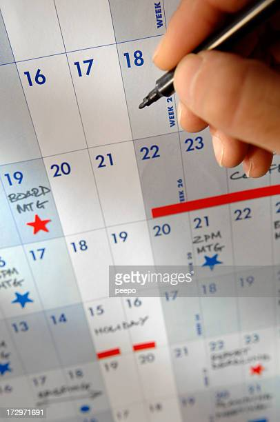 hand holding pen over calendar - today single word stock pictures, royalty-free photos & images