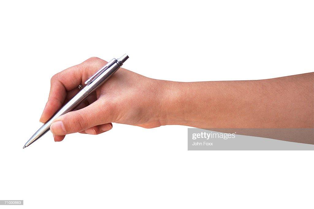 hand holding pen : Stock Photo