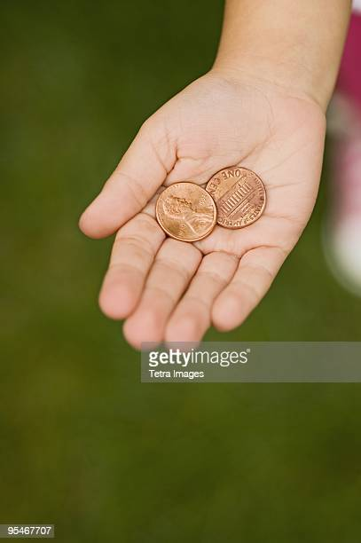 hand holding pennies - us penny stock pictures, royalty-free photos & images