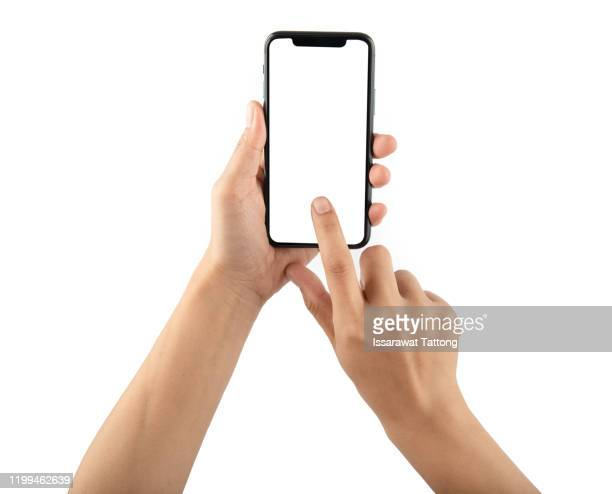 hand holding phone mobile and touching screen isolated on white background - human hand stock pictures, royalty-free photos & images
