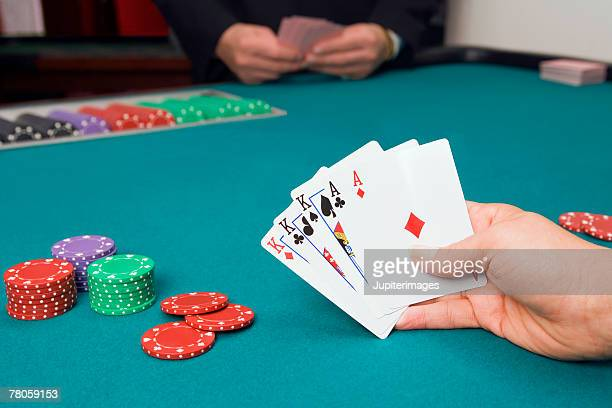 Hand holding poker cards