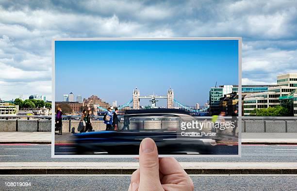 hand holding postcard of tower bridge, london - 葉書 ストックフォトと画像