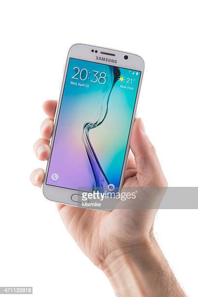hand holding samsung galaxy s6 with clipping path on display - samsung galaxy s stock pictures, royalty-free photos & images