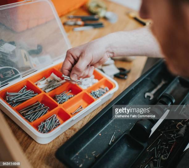Hand holding screws