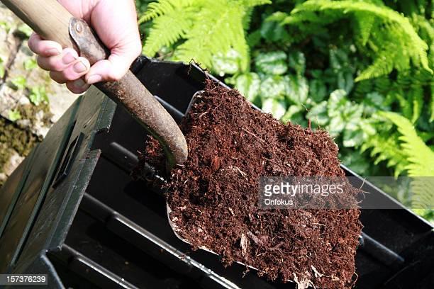 Hand Holding Shovel Full of Compost, Home Composting