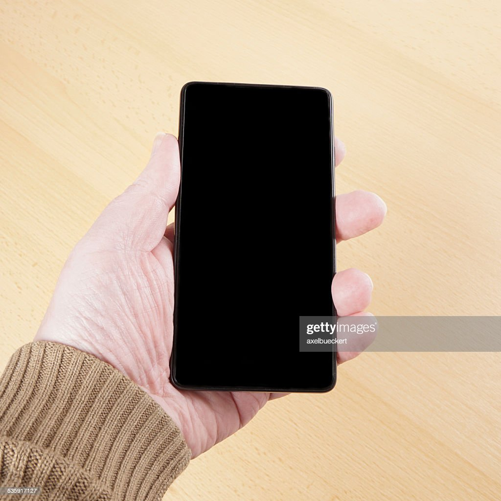 hand holding smart phone : Stock Photo