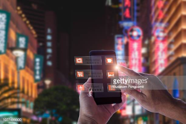 hand holding smart phone use ar application to check relevant information about the spaces around customer. - phone icon stock pictures, royalty-free photos & images