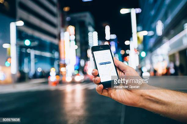Hand holding smartphone on the street