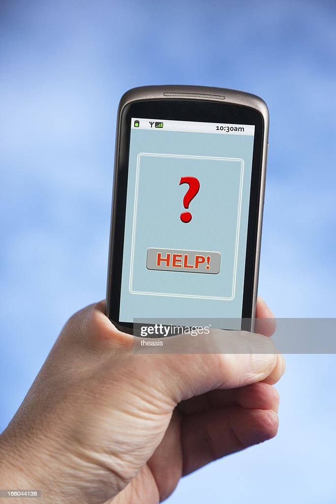 Hand holding smartphone with red question mark : Stock Photo