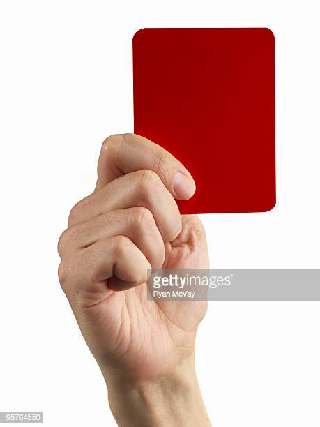 hand holding soccer red card