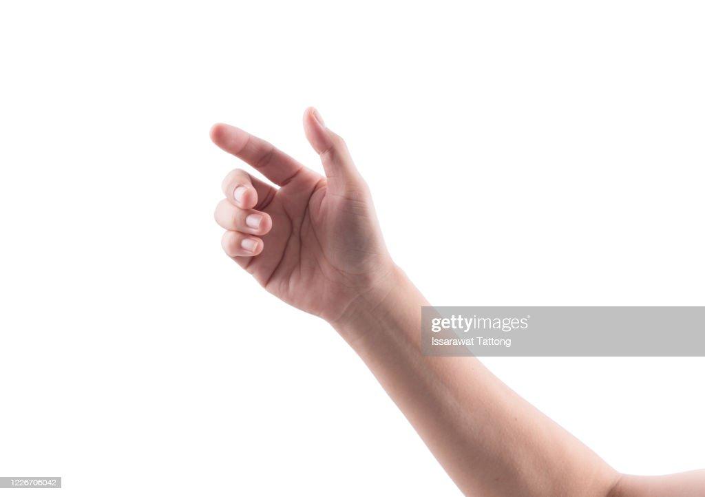 hand holding something like a bottle or smartphone on  isolated white background. : Photo