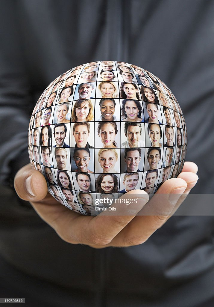 Hand holding sphere with grid of many faces : Stock Photo