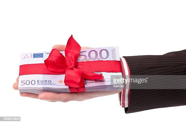 hand holding stack of 500 euro banknotes