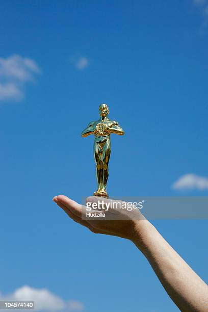 Hand holding statuette