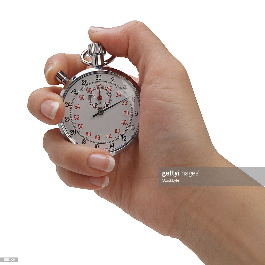 Hand holding stopwatch : Stock Photo