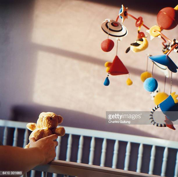 hand holding teddy bear - mobile stockfoto's en -beelden