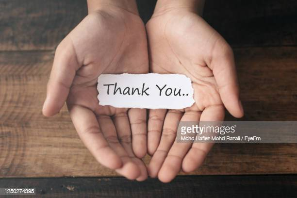 hand holding thank you note - thank you stock pictures, royalty-free photos & images