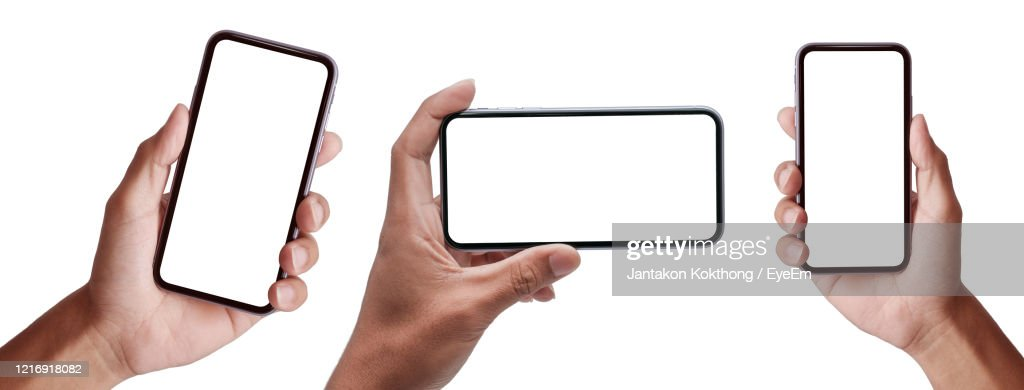 Hand Holding The Black Smartphoneand Modern Frameless Design Set In Rotated Positions Clipping Path : Stockfoto