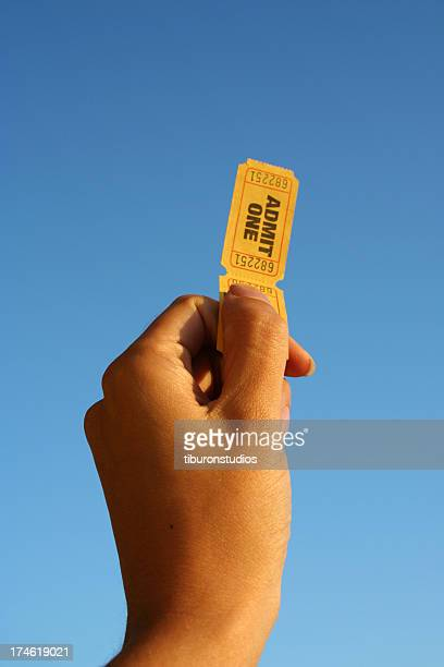 hand holding two tickets - ticket stock pictures, royalty-free photos & images