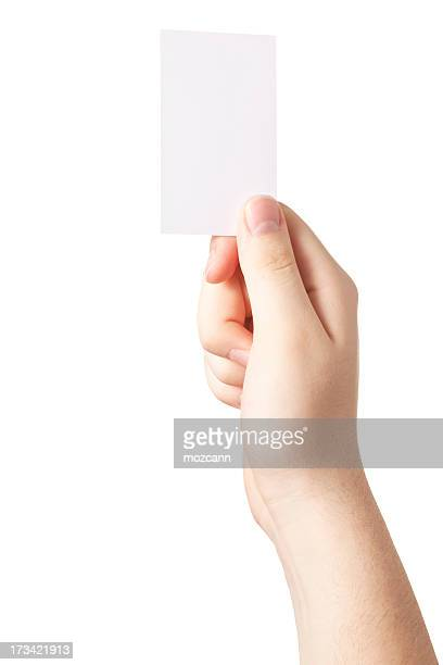 Hand holding up a blank white card
