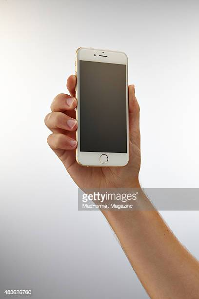 Hand holding up an Apple iPhone 6 taken on September 24 2014