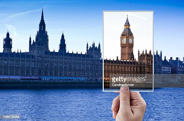 hand holding up postcard of big ben/westminster - postcard stock pictures, royalty-free photos & images
