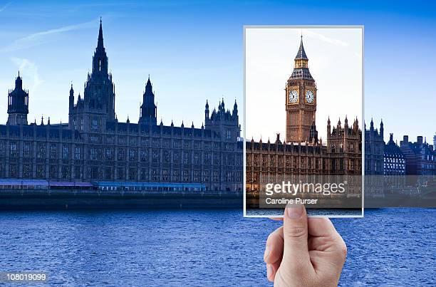 Hand holding up postcard of Big Ben/Westminster