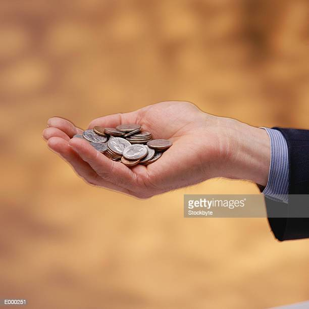 Hand holding US coins