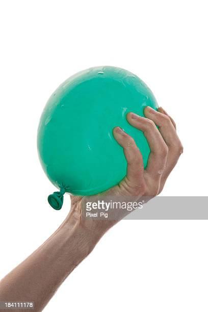 Hand holding Wasser Balloon