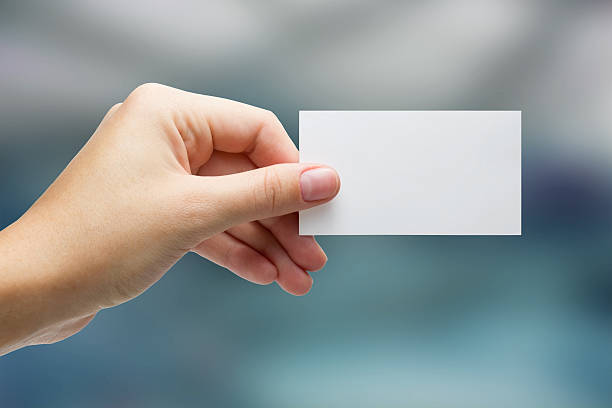 Free hand and business card images pictures and royalty free stock hand holding white business card on blurred background colourmoves
