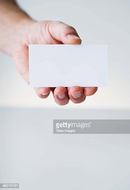 hand holding white card - business cards stock photos and pictures