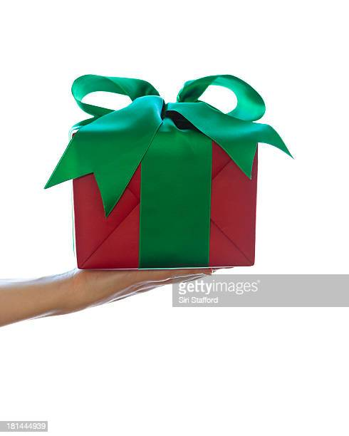 Hand holding wrapped Christmas present