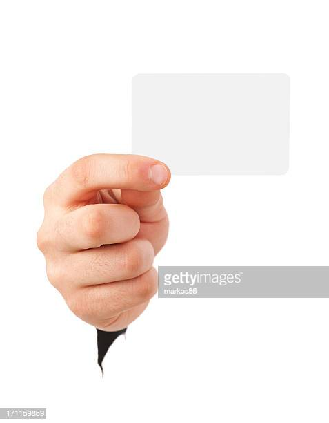 A hand holds a blank business card facing the viewer