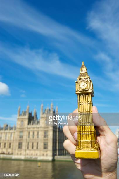 Hand Holds Big Ben Souvenir by Houses of Parliament