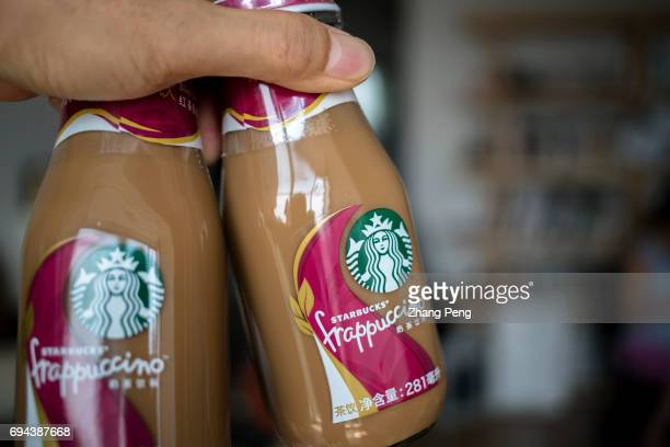 Hand holds blacktea taste Starbucks bottled Frappuccino arranged for photography In the first quarter of 2017 targeting to the Chinese consumers...