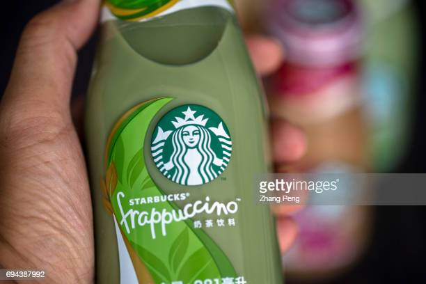 Hand holds matcha taste Starbucks bottled Frappuccino arranged for photography In the first quarter of 2017 targeting to the Chinese consumers...