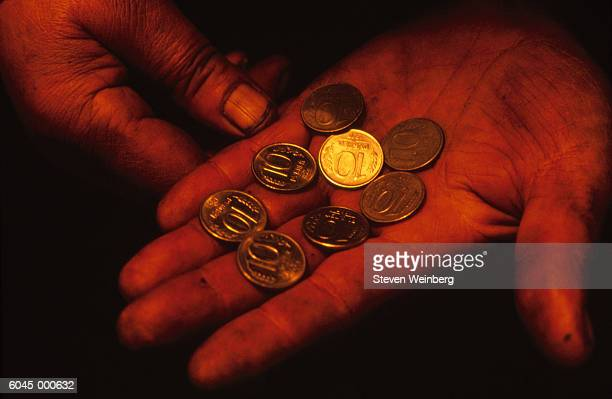 Hand Holds Rubles and Kopecks