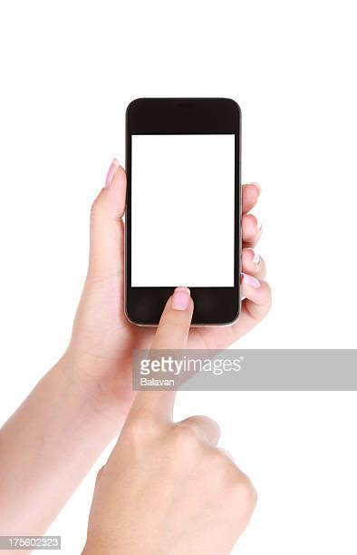 Hand holds smartphone on white background